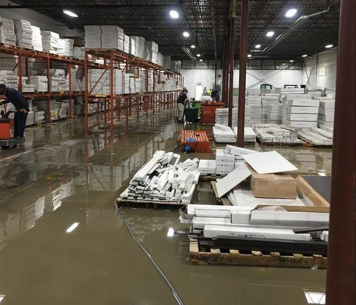 Warehouse with water on ground