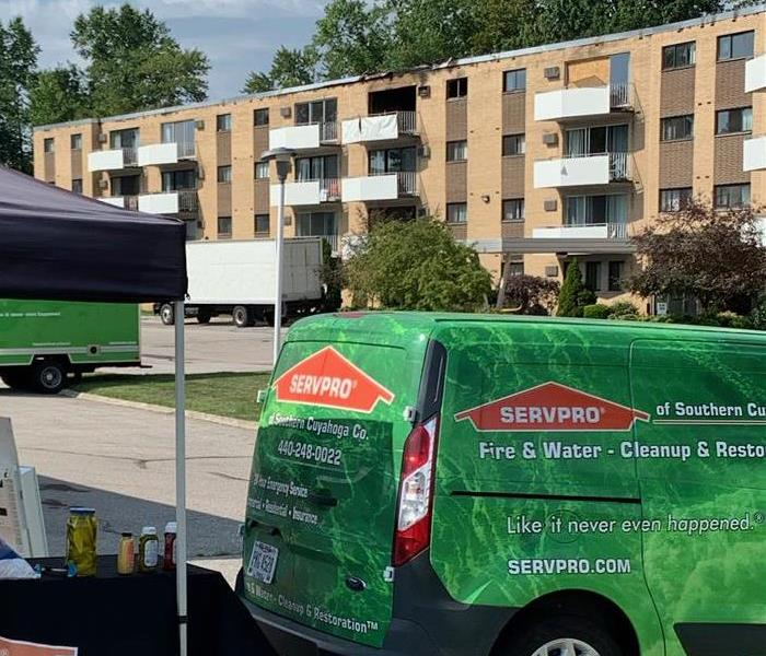 SERVPRO vehicles in front of apartments that has fire damage