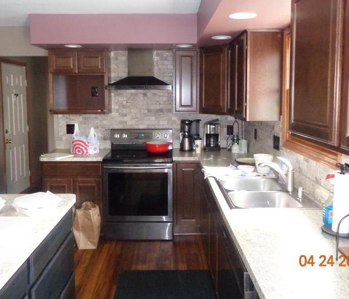 Kitchen with new wood flooring, appliances and cabinets.